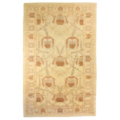 Large Turkish Donegal Rug with Brown and Gray Botanical Details on Ivory Field