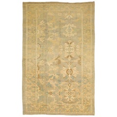 Large Turkish Donegal Rug with Ivory and Brown Floral Patterns