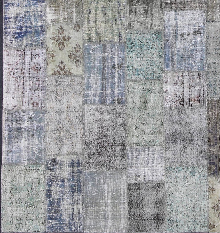 Large Turkish patchwork rug in Gray, Green, blue, Brown and neutral tones, rug tu-erd-7671, country of origin / type: Turkey / Patchwork, circa 1930.  This vintage Turkish rug is composed of various neutral-colored segments in a charming patchwork