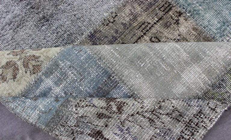 Large Turkish Patchwork Rug in Gray, Green, blue, Brown and Neutral Tones In Distressed Condition For Sale In Atlanta, GA