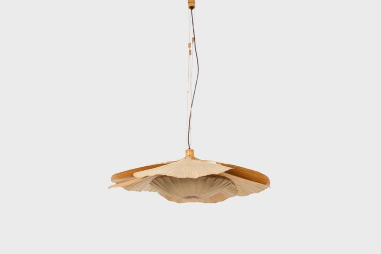 Rare large Uchiwa Hana chandelier by Ingo Maurer in very good condition.   Designed by Ingo Maurer for M design, Germany.   This lamp is handmade from bamboo, fabric and Japanese rice paper.   The lamp consists of six large fans hanging from a