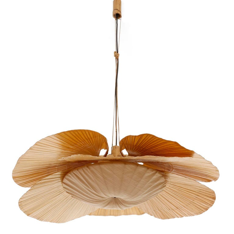 A large and sculptural 'Uchiwa' light fixture with six large rice paper palm shaped leaves connected to a bamboo shaft by Ingo Maurer, Germany, 1970s. A very hard to find piece, especially in this very good condition. This lamp was handmade of