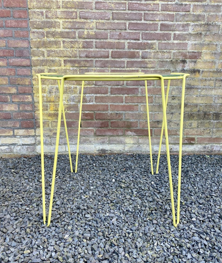 Rare yellow lacquered metal and glass side table designed by Arnold Bueno de Mesquita for Spurs circa 1955. De Mesquita was one of the initiators of the Dutch Goed Wonen Foundation in 1946, who promoted the new way of home furnishing. Style can be