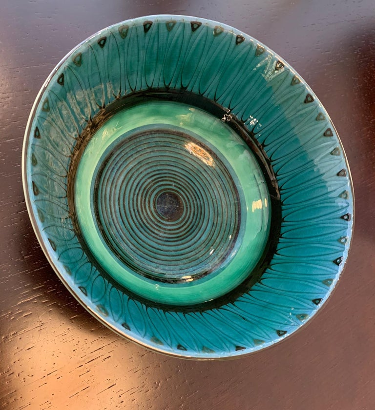 Large vintage Danish 1940s decorative hand painted art pottery bowl with a unique glaze by Herman H.C. Kähler (1876-1940). Kähler is a renown Danish ceramic factory since established in 1839.  The tall black 'slip applied' glazed bowl stands on a