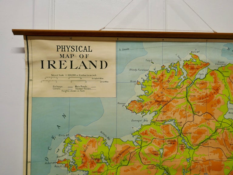 """Large University Chart """"Physical Map of Ireland"""" by Bacon  W&A K Johnston's Charts of Physical Maps By G W Bacon,  This is colorful Physical map of Ireland, it is large lithograph set on Linen mounted on wooden rods, the chart is in very good"""