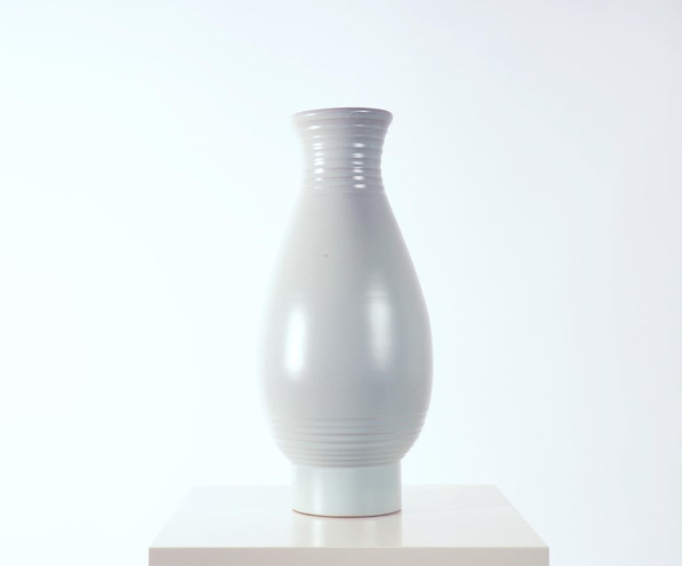 Pale blue floor vase designed by Ewald Dahlskog. He began his production at Bobergs Fajansfabrik for the big exhibition in Stockholm 1930 and was one of the pioneers of the modernist style in Swedish ceramics.   Free shipping worldwide.