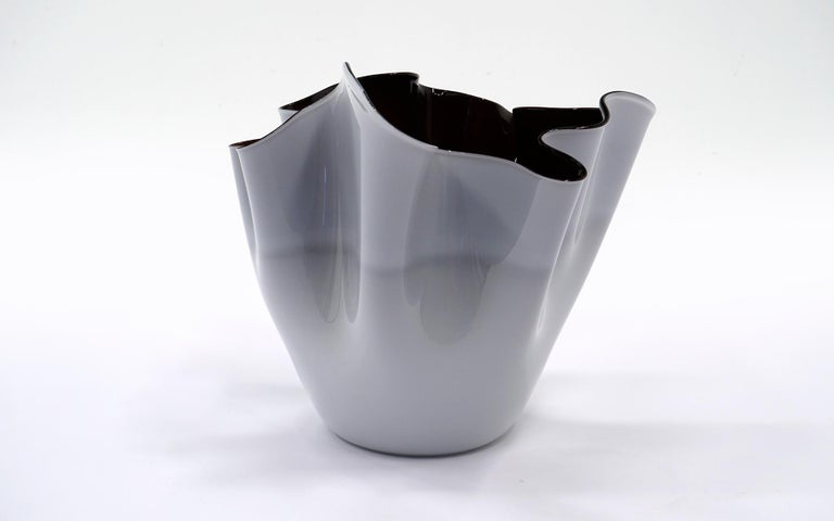 Beautiful, large Venini handkerchief vase or bowl designed by Fulvio Bianconi and Paolo Venini in 1948. It is an early production piece from the 1950s. The interior is very dark, almost black. The exterior is a rich white color. No chips, no