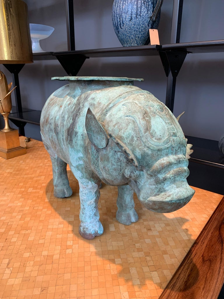 Depicting a mythological animal Hippopotamus, this sundial with a wonderful aged verdigris coloring over bronze. Perfect for outside space. Garden or also for indoor sculpture. Large scale and heavy, the Hippopotamus signifies strength and power.