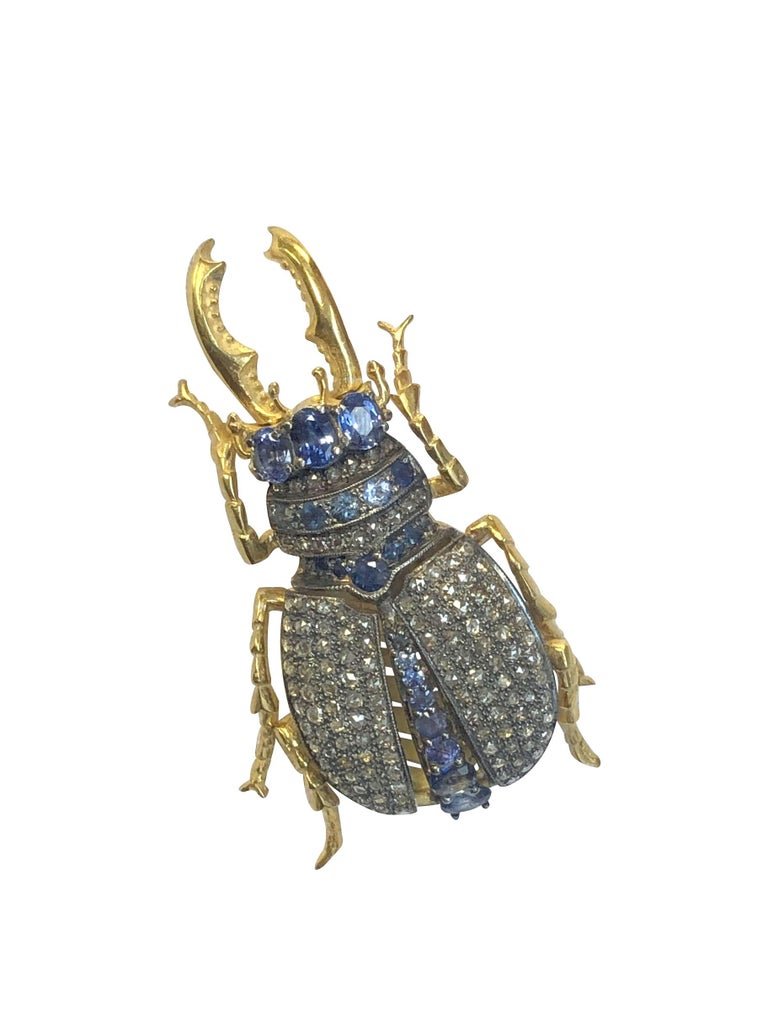 Large and impressive Beetle Form Brooch Pendant, measuring 2 1/4 inches in length X 1 1/4 inches wide, set with Rose cut Diamonds totaling approximately 2 Carats and further set with round and Oval Sapphires. This piece is masterfully Articulated,