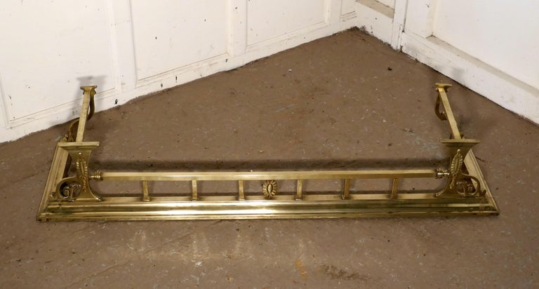 """Large Victorian Art Nouveau brass fender.   This is a beautifully designed Victorian brass fender it has Art Nouveau decoration worked in brass  The fender is in very good condition it is 8"""" high, and 48"""" long and 14"""" deep.  THH43."""