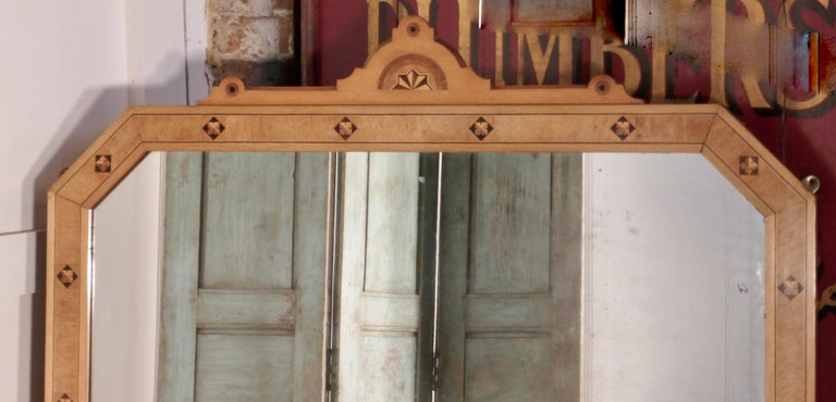 Large Victorian Arts & Crafts over mantle mirror   This is a very striking piece it has a tall rectangular shape with a decorative top, it is made in golden ash and maple with a little geometric inlay The mirror would set off the decoration of