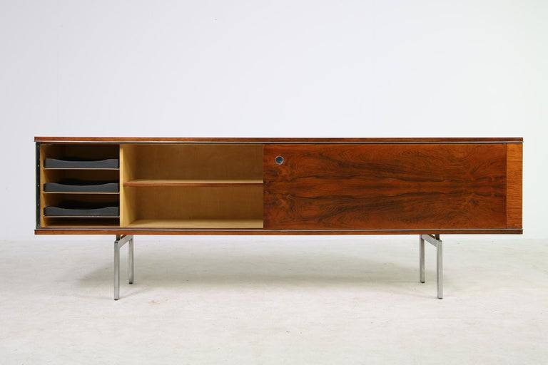 Great and large sideboard, Belgium or Netherlands, 1960s with a metal base, very detailed design and metal accents, the sliding doors are reversible, beautiful vintage piece with beautiful wood structure, colors and patina. The wood should be