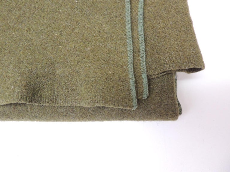 Army green wool blanket. (finished on all sides) Reversible Size: 63 W x 84 L.