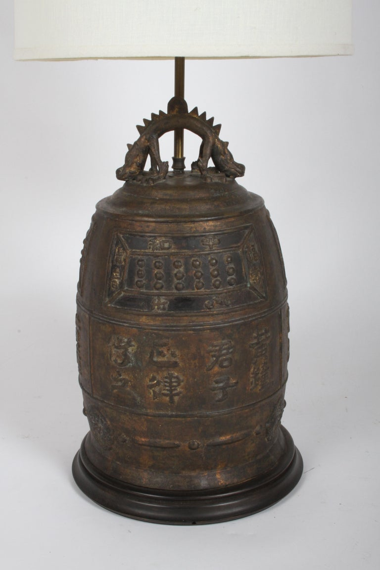 Large vintage Asian / Oriental table lamp of a bronze drum with symbols, signs of gilt , with two headed dragon at top. Came out of an interior of a mid-century modern home, possibly from the 50's or earlier. Working condition, will get new cord,