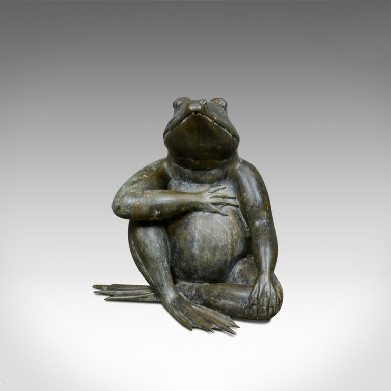 This is a large, vintage, bronze frog water feature. A decorative garden ornament dating to the 20th century.  Large, 0.5M (20 inches) high Exceptional detail and presentation Beautifully patinated bronze Sat, legs crossed in casual