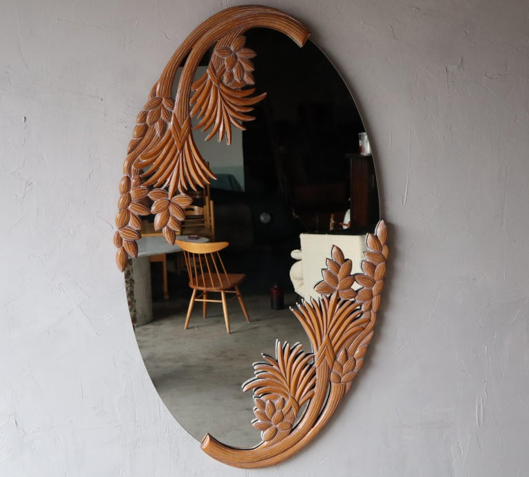 This stunning botanical wall mirror has an intricately carved and cerused wood frame. The mirror is fairly substantial measuring almost 5ftx3ft. It can be hung vertical or horizontal and has hanger on the back for either configuration. It would look