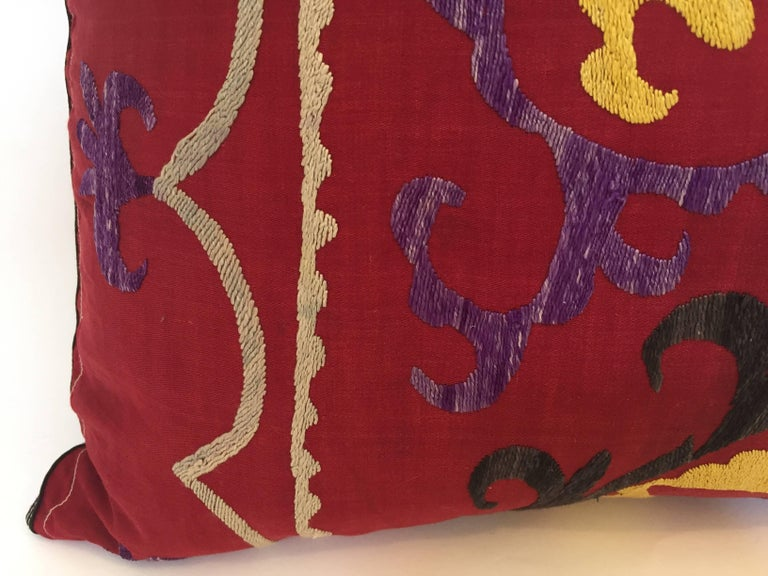 Large vintage colorful Suzani embroidery throw pillow red with colorful threads. 