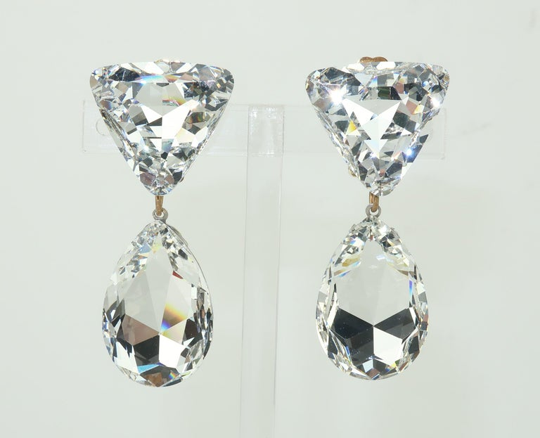 Diamonds might be a girl's best friend but crystals are her favorite sidekick!  These 1980's large crystal dangle earrings are dazzling and delightful ... sure to put a glamorous touch on any evening ensemble.  The gold tone clip on hardware keeps
