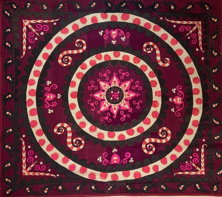 Beautiful artisan Suzani textile made of hand embroidery silk, of floral and vine motifs with circle of life ring. This Suzani is very special because it is embroidered all-over, there is no empty space, that show the time and effort of the artist