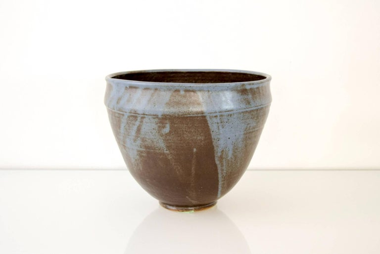 This large vintage Mid-Century Modern decorative ceramic pottery bowl is circa 1960. It was handcrafted and features a simple modernist design with a tall proportion and gorgeous blue tones.  Dimensions: Diameter 9 3/4