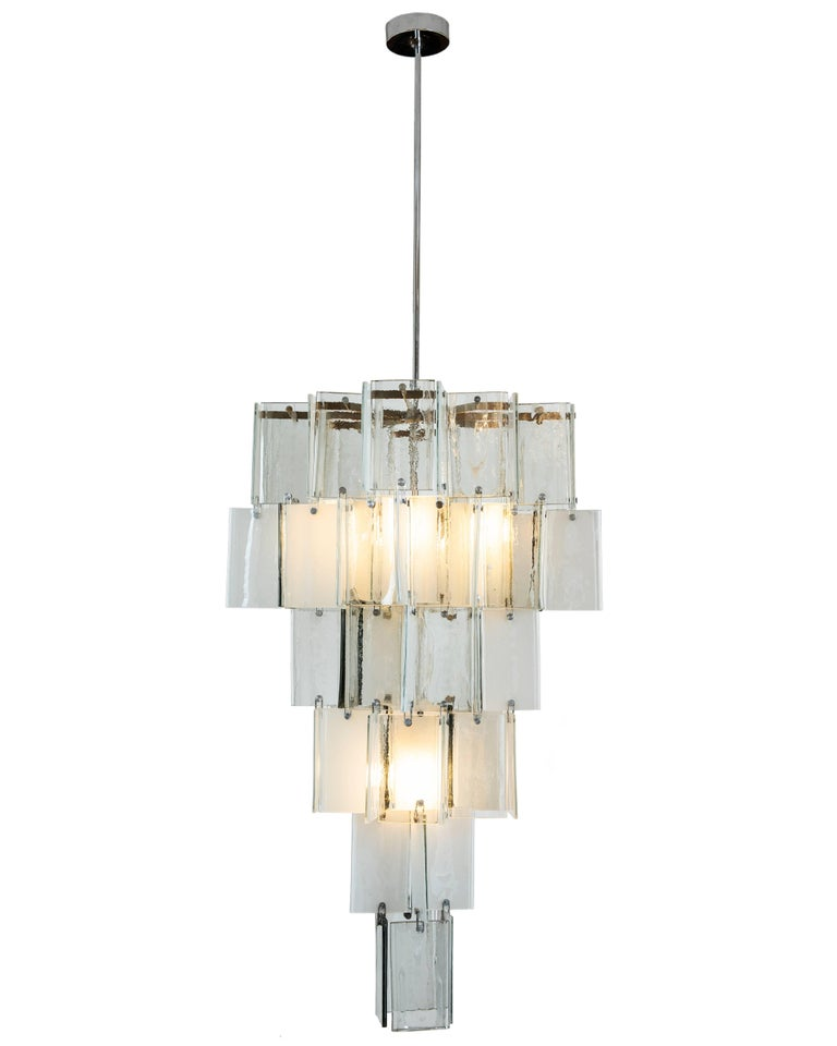 This important and unique Murano light originates from a Toronto home. It was custom-made for the client in the 1970s using handblown opaque clear and white glass pieces attributed to AV Mazzega. The body of fixture with glass measures 48