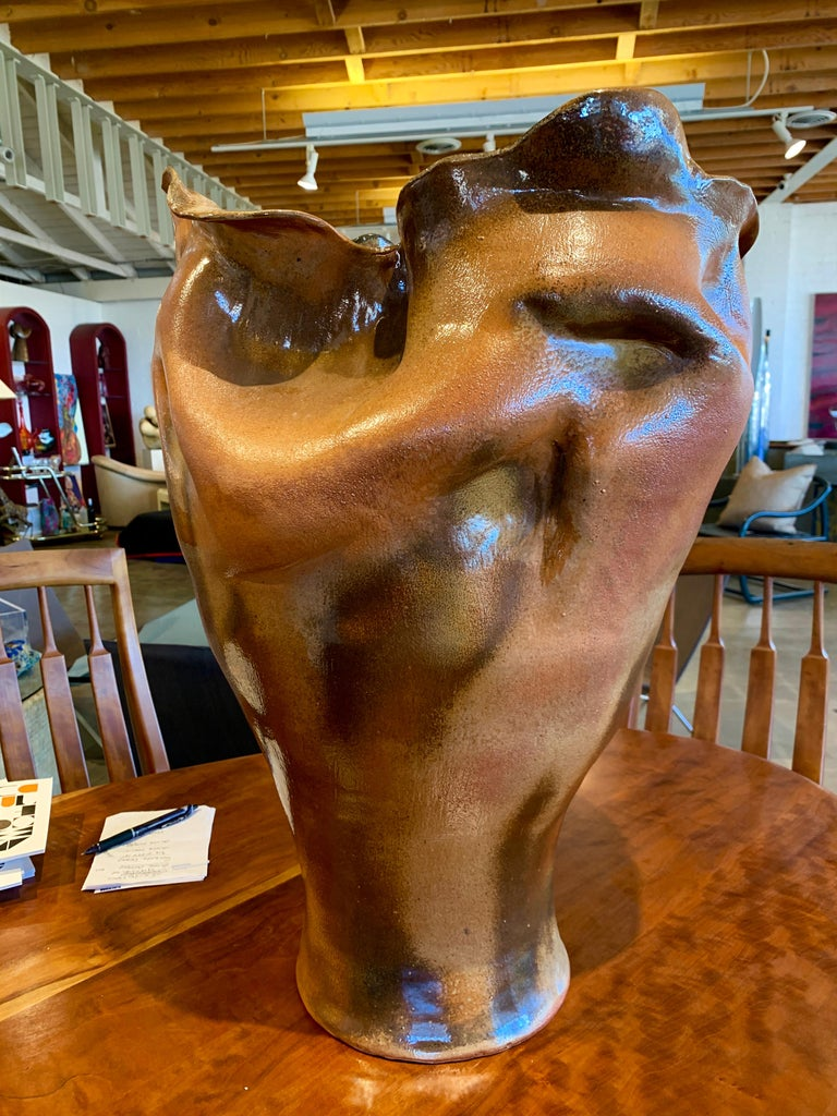 An extremely well executed large pottery vessel attributed to Paul Soldner one of the first students of Peter Voulkos. He was a master of Raku and low temperature salt firing. This vessel is large, approximately 24 inches tall. It has a beautiful