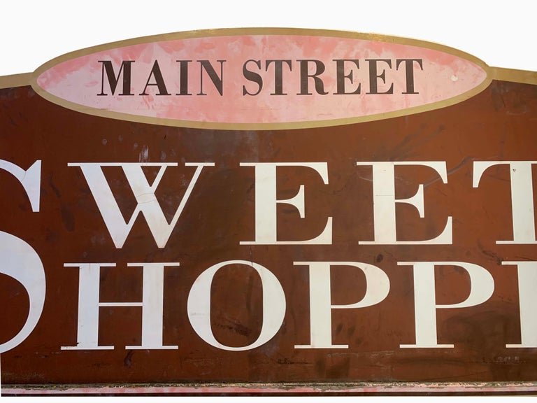 Large one of a kind wooden sign with fantastic details. Great colors and intricate shapes. Originally hung outside a CT sweet shop.