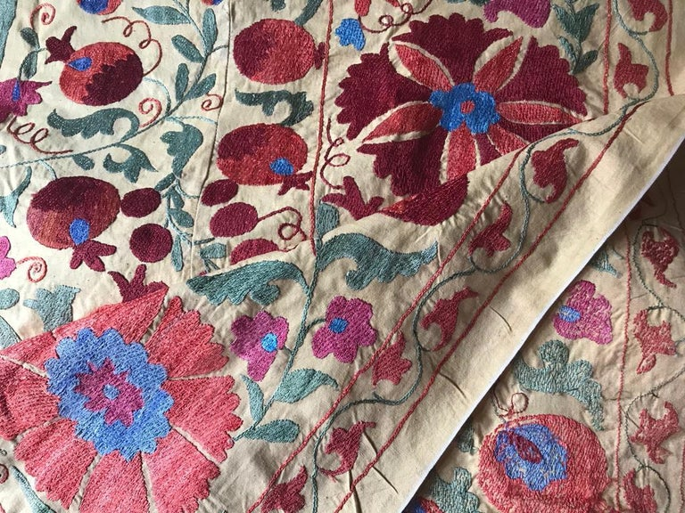 Wonderful colors and design on this large vintage Suzani blanket with all the care and retail of hand embroidered craftsmanship with silk thread on cotton.