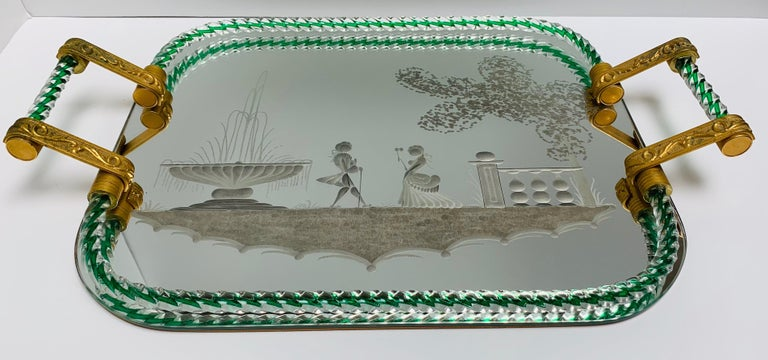 Large vintage Venetian mirrored tray with brass cast handles, and green twisted rope detail.