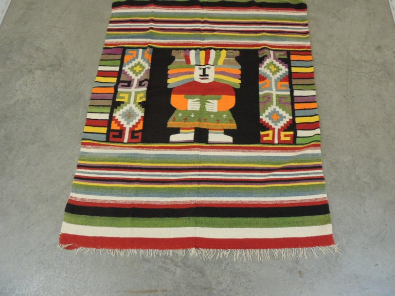 Large vintage Peruvian warrior throw with colorful stripes.