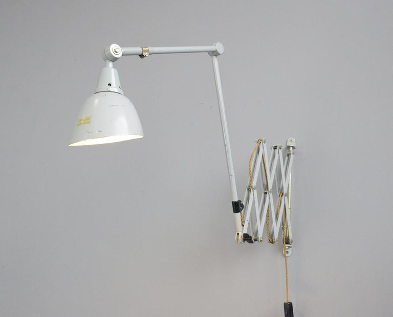 Large wall-mounted scissor lamp by Midgard, circa 1960s.  - Large extendable scissor mechanism - Two large articulated arms - Aluminium shade with original gold makers label - Takes E27 fitting bulbs - German, circa 1960s. - Shade measures: