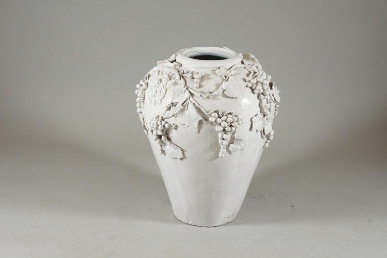 Exquisite white glazed Jar with masks and grapevine motifs. Signed Vincent Garnier: France.