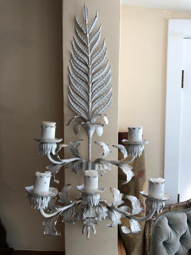 Large white Hollywood Regency iron wall sconce. This stunning wall sconce would pop against any bright busy wallpaper. Very West Palm Beach in style. Designed for candles but could be hardwired. Please request a parcel shipping quote for a more