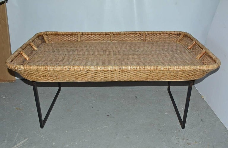 """Wonderfully large wicker rattan tray coffee table on metal stand. Perfect for porch, patio, casual den or sunroom.  Height of tray - 4.50"""" Measurement for metal base - D 24"""", W 42"""", H 17""""."""
