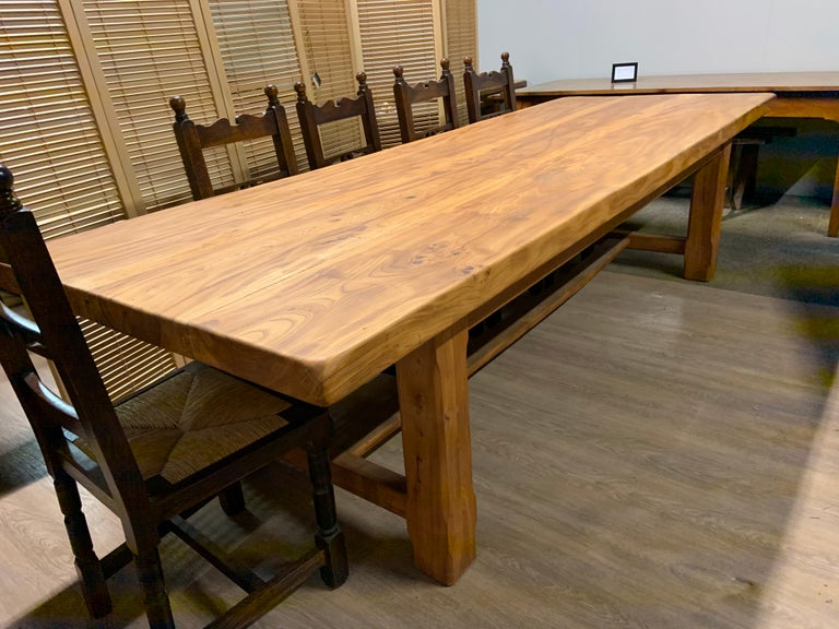 Large rustic wide pale elm Farmhouse table with substantial well figured thick top, consisting of three planks. The top sits on four sturdy thick jointed elm legs united by an H stretcher.