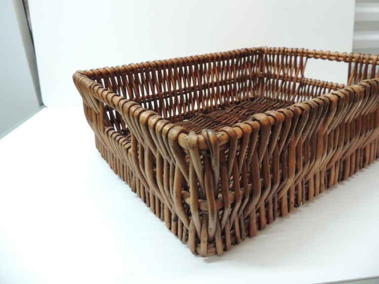 Large willow magazine basket with handles.