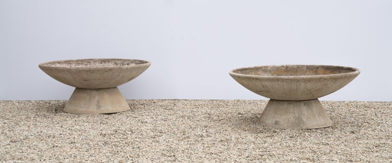 Matching pair of large concrete bowl planters by Swiss architect Willy Guhl for Eternit on stand. Wonderful patina and character. Pair available - Priced individually.