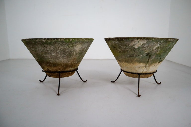 A set of two Mid-Century Modern large saucer planters of composition stone for an indoor or outdoor garden, garden room, or terrace, designed by the iconic Willy Guhl in the early 1960s. They have a lovely naturally-weathered surface.