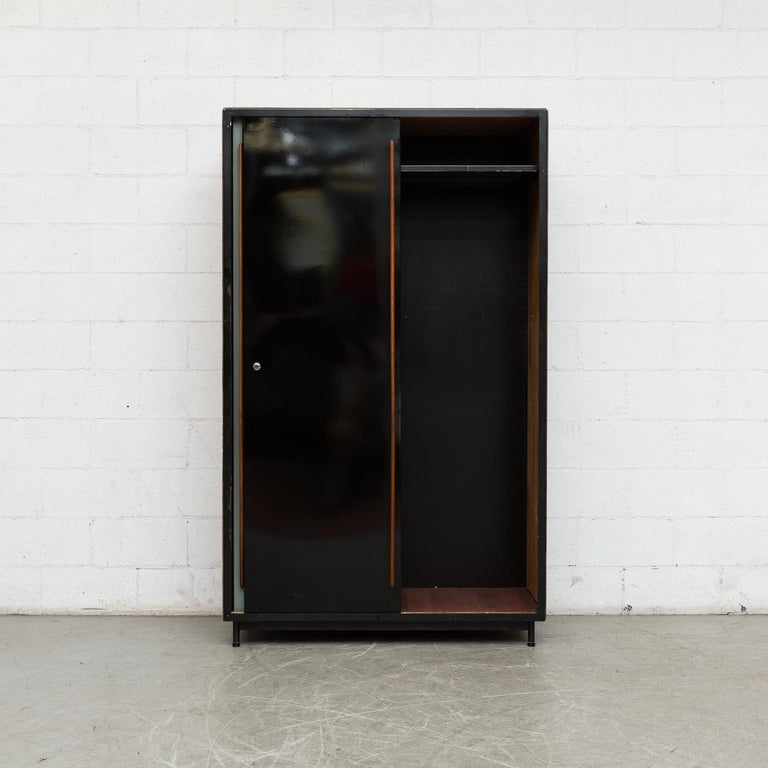 Large Willy Van Der Meeren wardrobe for Tubax, Belgium, 1952. Wood paneled sides, tapered mahogany door pulls and grey and black enameled metal doors with black enameled metal frame. This version has two lower metal drawers on the left side. Visible