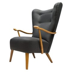 Large Wingback Chair in Anthracite Upholstery with Wooden Armrests, 1950s