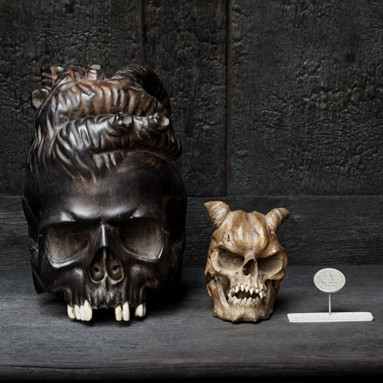 Set of rare hand-carved sculptures of human skulls, both of them have bone teeth. Very intriguing, weird and demonesk looking skulls, so you can imagine why I had to have them.