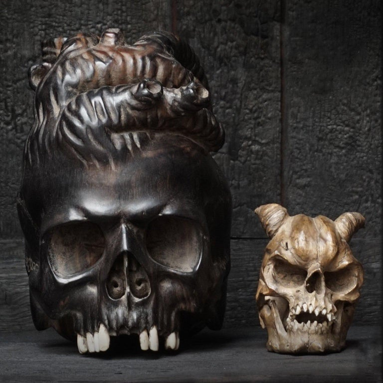 Unknown Large Wooden Hand-Carved Ebony Heart Skull and Small Demon Skull For Sale