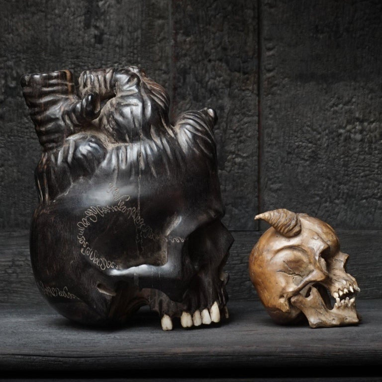 Bone Large Wooden Hand-Carved Ebony Heart Skull and Small Demon Skull For Sale
