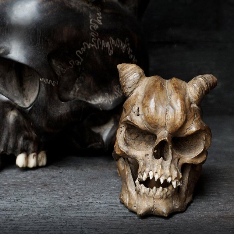 Large Wooden Hand-Carved Ebony Heart Skull and Small Demon Skull For Sale 2