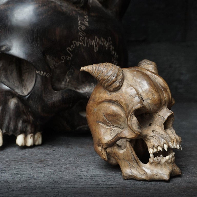 Large Wooden Hand-Carved Ebony Heart Skull and Small Demon Skull For Sale 3