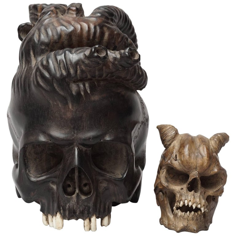 Large Wooden Hand-Carved Ebony Heart Skull and Small Demon Skull For Sale