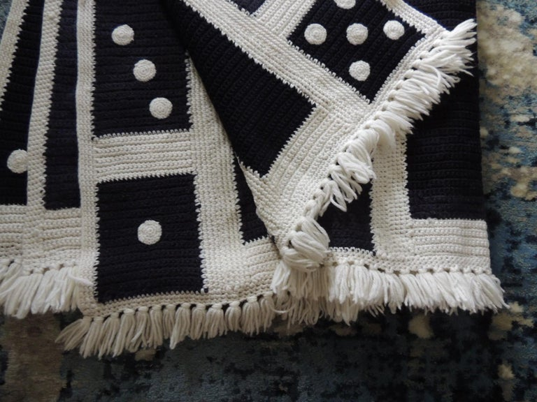 Large woven black and white Afghan throw. Reversible from solid black and white to a domino pattern. Small fringes at both ends. Handwoven in Iceland. Size: 50