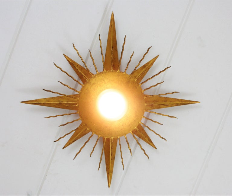 Large Wrought Gilt Iron Starburst Sunburst Ceiling Light Fixture, Spain, 1950s In Excellent Condition For Sale In Barcelona, ES