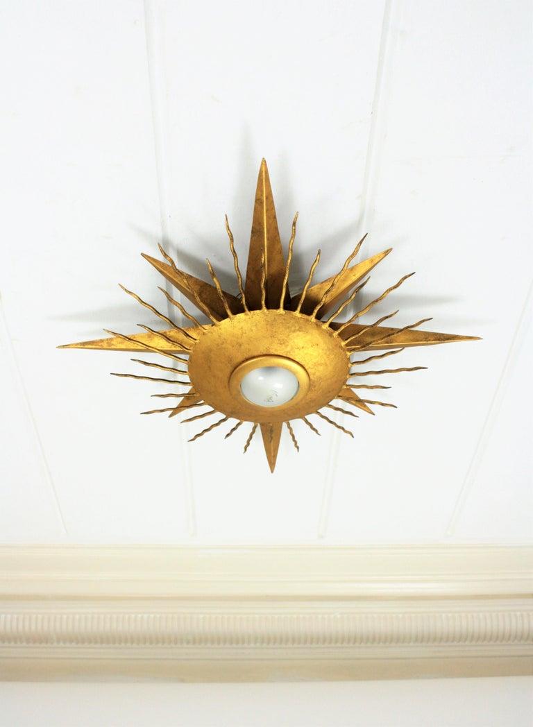 20th Century Large Wrought Gilt Iron Starburst Sunburst Ceiling Light Fixture, Spain, 1950s For Sale