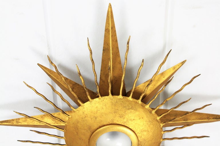 Gold Leaf Large Wrought Gilt Iron Starburst Sunburst Ceiling Light Fixture, Spain, 1950s For Sale